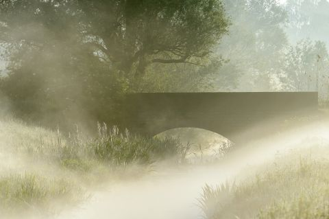 Misty bridge over stream Coupure